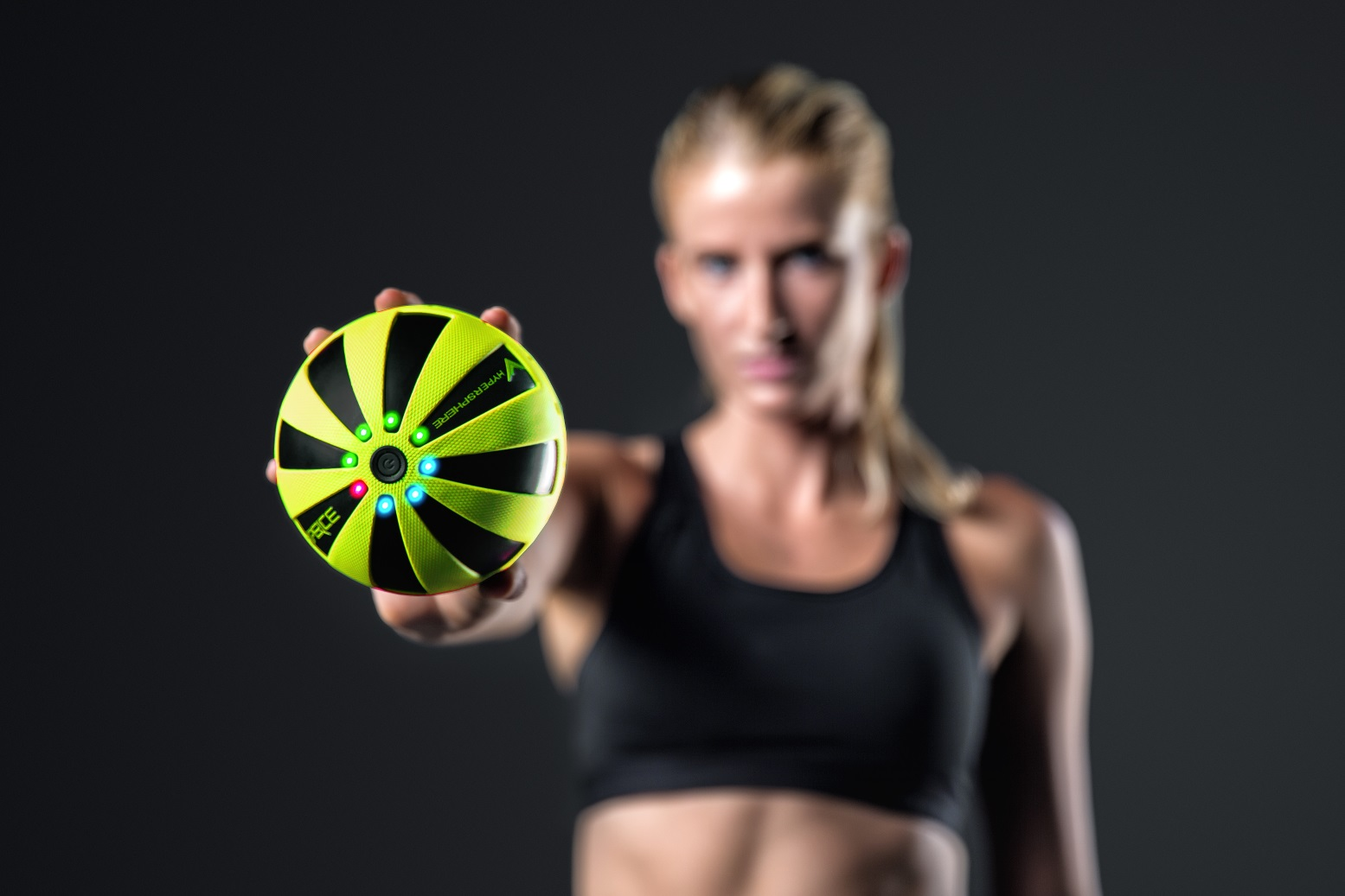 Female Holding Hypersphere Vibrating Ball