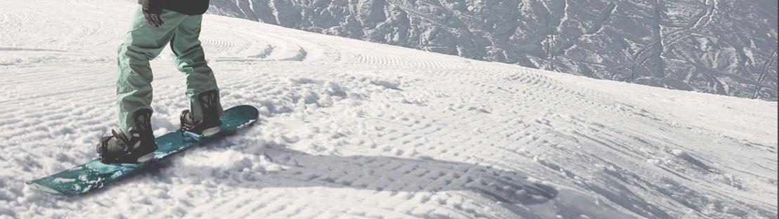 Beginner Snowboarder at Slopes