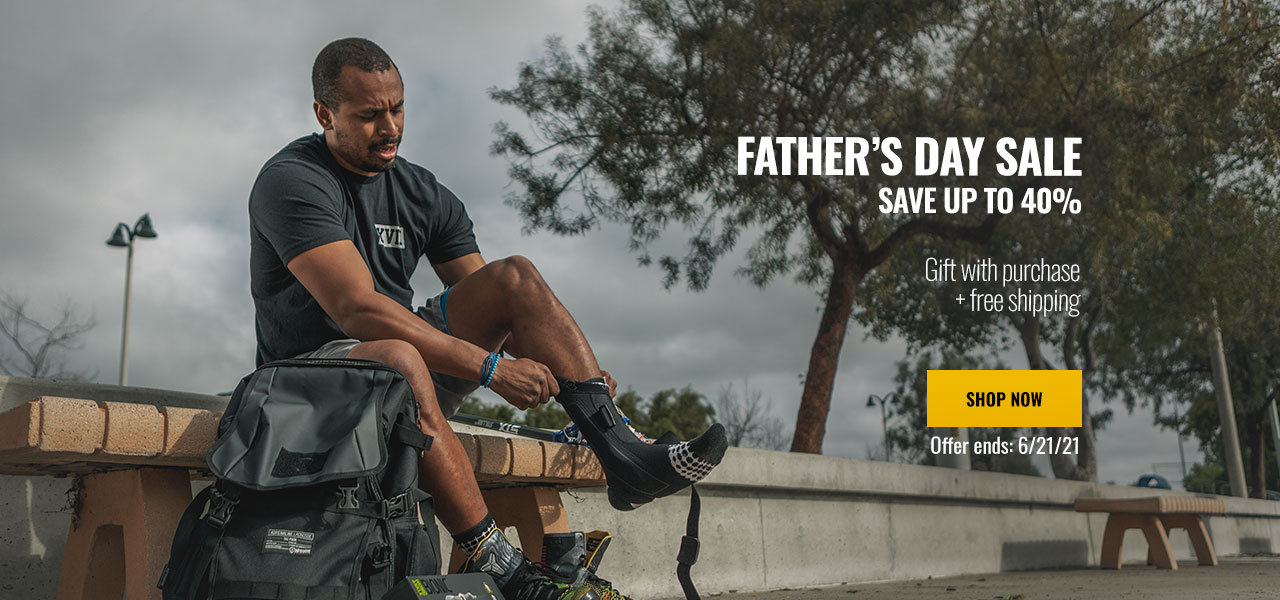 Fathers Day Sale - Male athlete wearing ankle brace sitting on bench